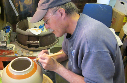 Scott Shaffer making handcrafted pottery in his studio