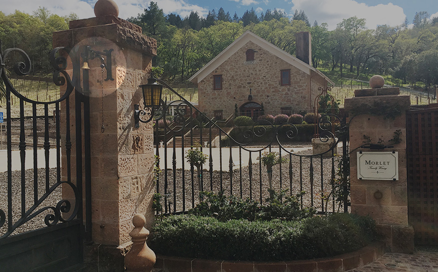 Main gate of Morlet Family Vineyards featuring bells from Ciani Atelier